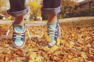 Park Terramar Apartments - Stock photo of human feet in shoes about to jump over dried leaves